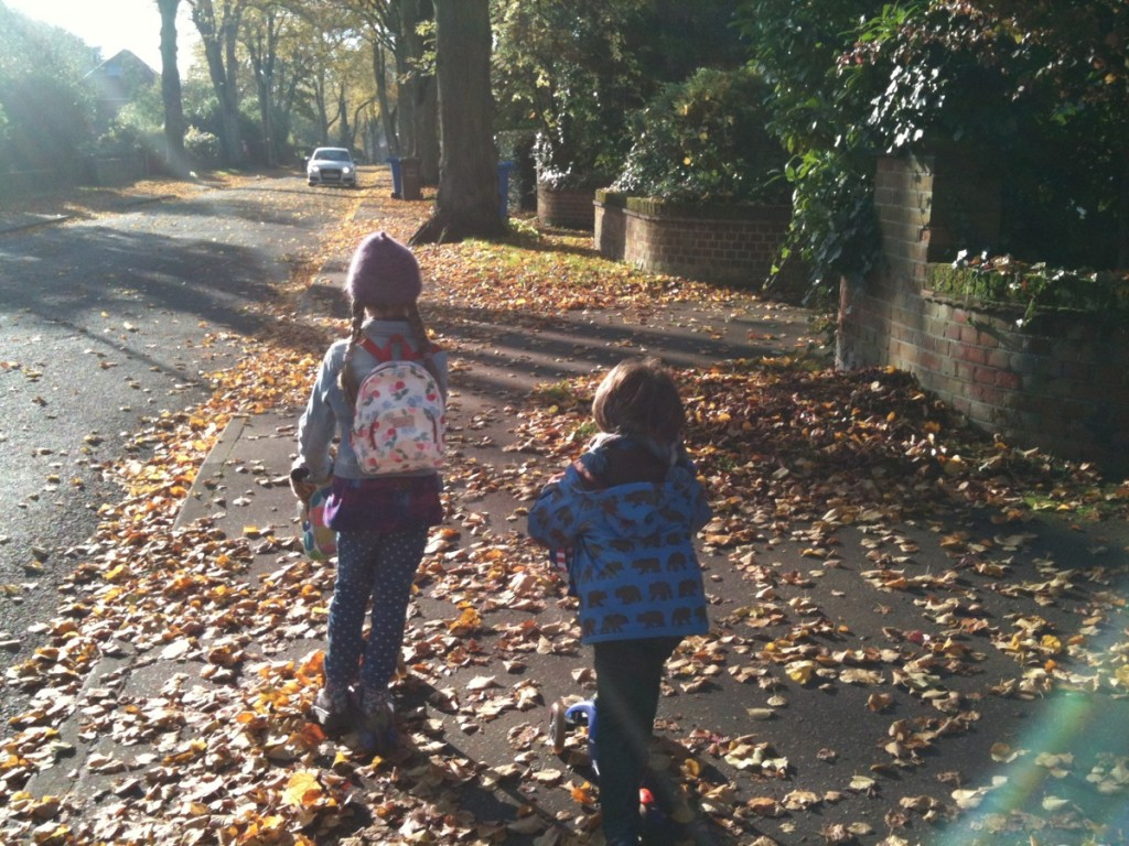 Autumn morning scooting to school